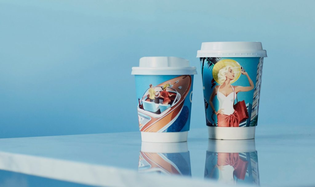 Disposable coffee cups featuring illustrations